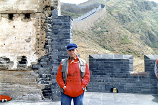 James Merrill in Mao cap on the Great Wall, 1986