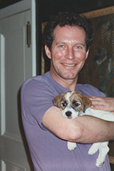 Peter Hooten with Cosmo as puppy, c. 1991
