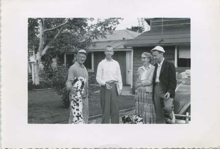 DJ and family (mother Mary, father George, brother George) in Jackson driveway, Tarzana, 1955.