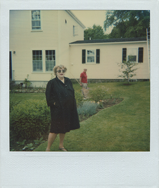 Eleanor Perényi, visiting Mary McCarthy and James West (in background), Castine, ME. (WUSTL)